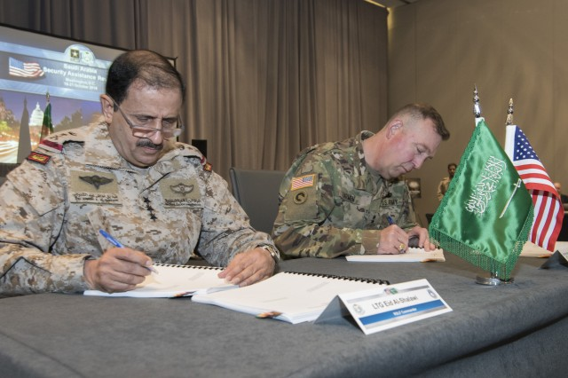 Lt. Gen. Eid Bin Al-Shalawi, Royal Saudi Land Forces commander and Maj. Gen. Stephen Farmen, commander of the U.S. Army Security Assistance Command, sign the executive minutes following the completion of the 3rd annual U.S. and Saudi Grand Security Assistance Review held in Washington, D.C. Oct. 16-21.