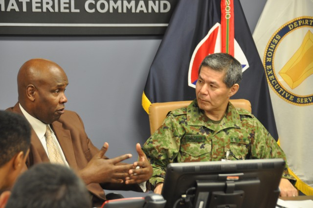 Kevin Bostick answers logistics questions from Japanese army Maj. Gen. Shin Nozawa Oct. 24 at Army Materiel Command headquarters on Redstone Arsenal, Alabama. Bostick is the director of AMC's Logistics Integration Directorate, and Nozawa is the director of the Japanese Ground Self Defense Force's Logistics Department.