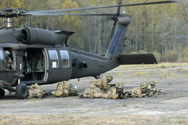 PANEVEZYS, Lithuania - Paratroopers from 2nd Battalion, 503rd Infantry Regiment (Airborne), 173rd Infantry Brigade Combat (Airborne), disembark from a helicopter after being dropped off at their objective area Oct. 20 during Exercise Strong Shield. The exercise, which ran through Oct. 23, is a Lithuanian hosted 96-hour continues exercise designed to test the nation's ability to work with different internal and external agencies to marshal their capabilities and defend their position. The Paratroopers are in Lithuania training with their Lithuanian partners as part of Atlantic Resolve. Atlantic Resolve is a U.S. led effort being conducted in Eastern Europe to demonstrate U.S. commitment to the collective security of NATO and dedication to enduring peace and stability in the region. The helicopters were flown by Soldiers from 3rd Battalion, 501st Aviation Regiment, 1st Armored Division Combat Aviation Brigade.