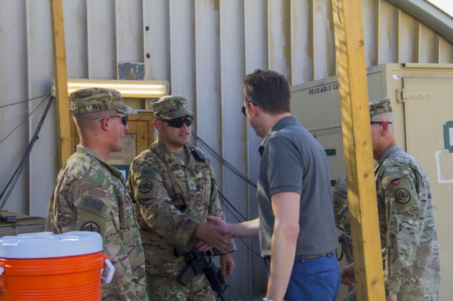 U.S. Army Staff Sgt. Nicholas Szyman shakes hands with Secretary of the Army Eric Fanning during his visit to Train, Advise and Assist Command-East in eastern Afghanistan Sept. 16, 2016.