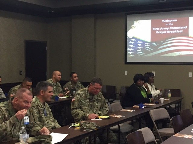 First Army Solciers and Civilians fellowship during the Prayer Breakfast hosted by the Unit Ministry Development Training held at Rock Island Arsenal, Illinois Oct. 19.