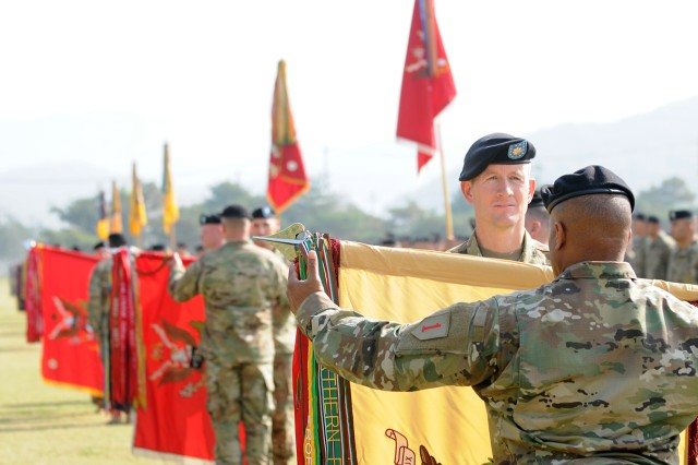 "Battalions from the 1st Armored Brigade Combat Team, 1st Infantry Division ""un-case"" their colors during a Transfer of Authority ceremony at Camp Casey on October 27."