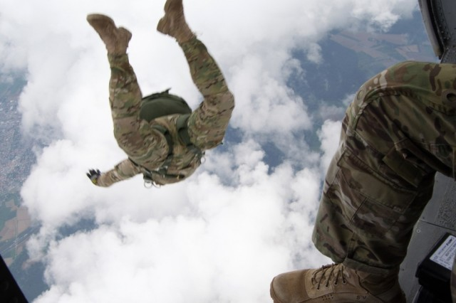 Malmsheim Drop Zone, Germany- American Paratrooper from 1st Battalion 10th Special Forces Group conducts a military free-fall jump from UH-60L black hawk supported by the Army National Guard helicopter Taskforce Aug 5. (U.S. Army Photo by Sgt. Shaun Morey)