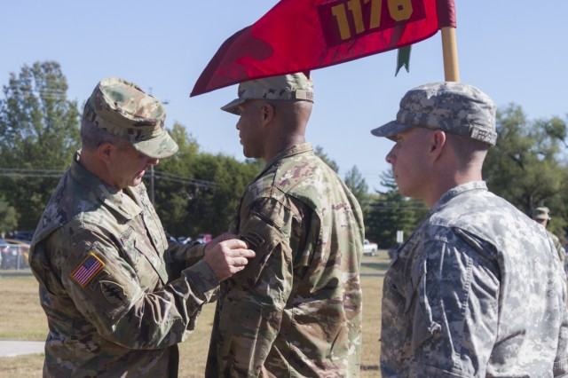 "Brig. Gen. Scott Brower, acting senior commander for the 101st Airborne Division (Air Assault), places the 101st Abn. Div. patch on Capt. James Huff, commander of the 1176th Transportation Company with the Tennessee National Guard, Oct. 23, 2016, as part of the patching ceremony in Smyrna, Tn. The 1176th Trans. Co. Soldiers will wear the 101st Abn. Div. patch as a symbol of their partnership with the 101st Abn. Div. Sustainment Brigade ""Lifeliners"" as they participate in the U.S. Army's Associated Unit Pilot Program."
