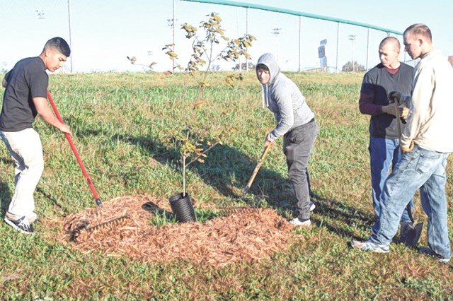 Members of the Air Force Detachment apply mulch around trees during the annual Make a Difference Day Saturday. More than 30 Fort Leonard Wood-connected organizations took part in dozens of volunteer service projects around the installation and in surrounding communities.