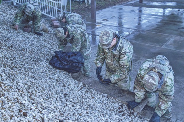 Soldiers weed a rock bed at Piney Valley Golf Course during the annual Make a Difference Day Saturday. More than 30 Fort Leonard Wood-connected organizations took part in dozens of volunteer service projects around the installation and in surrounding communities.