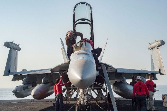 Sailors conduct pre-flight inspections on an E/A-18G Growler assigned to Electronic Attack Squadron 130 on the flight deck of the aircraft carrier USS Dwight D. Eisenhower in the Persian Gulf, Oct. 18, 2016. Ike and its Carrier Strike Group are deployed in support of Operation Inherent Resolve, maritime security operations and theater security cooperation efforts in the U.S. 5th Fleet area of operations.