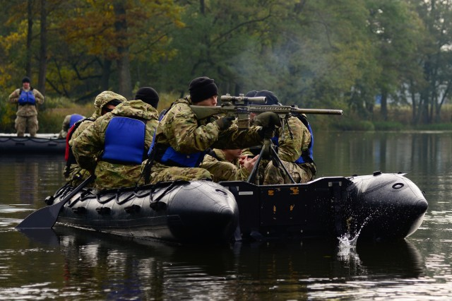 A U.S. Soldier, assigned to the 173rd Airborne Brigade, fires at a target from a Zodiac boat during the European Best Sniper Squad Competition at the 7th Army Training Command's Grafenwoehr Training Area, Germany, Oct. 24, 2016. The European Best Sniper Squad Competition is an Army Europe competition challenging militaries from across Europe to compete and enhance teamwork with Allies and partner nations. (U.S. Army photo by Spc. Emily Houdershieldt)