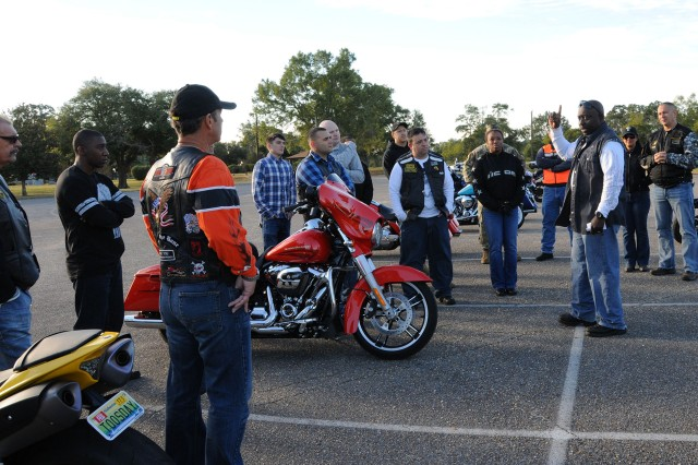 Riders receive a briefing before they take off from the U.S. Army Aviation Museum parking lot as they embark on the motorcycle mentorship ride.