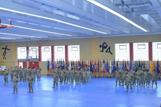 BAUMHOLDER, Germany -- The 569th Human Resources Company, the newest part of the 21st Theater Sustainment Command's 16th Special Troops Battalion, stand at parade rest before the start of the activation ceremony held Oct. 25 at the Hall of Champions Fitness Center on Smith Barracks. (Photo by Staff Sgt. Daniel Wyatt, 16th Sustainment Brigade Public Affairs)