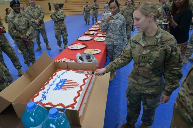 BAUMHOLDER, Germany -- Capt. Katherine Hansen, the inaugural commander of the 569th Human Resources Company, 16th Special Troops Battalion, cuts the ceremonial cake following the activation ceremony held Oct. 25 at the Hall of Champions on Smith Barracks. (Photo by Staff Sgt. Daniel Wyatt, 16th Sustainment Brigade Public Affairs)