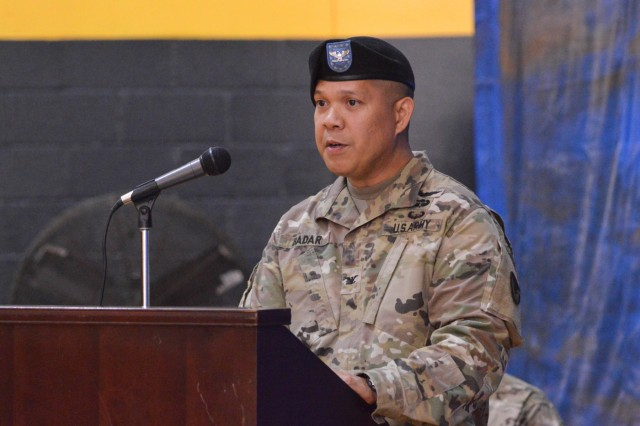 SCHOFIELD BARRACKS ⎯ Col. Patrick J. Badar, commander of 413th Contracting Support Brigade, offers remarks during the Uncasing and Re-Stationing Ceremony at Martinez Physical Fitness Center aboard Schofield Barracks, Oct. 25, 2016. (U.S. Army photo by Kristen Wong)