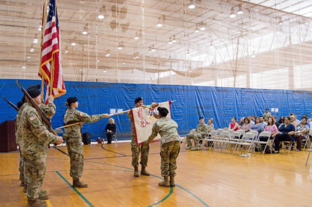 SCHOFIELD BARRACKS ⎯ Col. Patrick J. Badar (behind the guidon), commander of 413th Contracting Spt. Bde., and Lt. Col. Daphne H. Austin (in front of the guidon), commander, 921st Contracting Bn., uncase the colors during the Uncasing and Re-Stationing Ceremony at Martinez Physical Fitness Center aboard Schofield Barracks, Oct. 25, 2016. (U.S. Army photo by Kristen Wong)