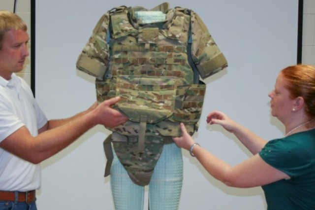 To promote collaborative science and technology projects and multidisciplinary work, the U.S. Army Research Laboratory will hold its third Open Campus Open House for industry, academia and fellow government agencies at the Adelphi Laboratory Center Nov. 16-17. Researchers Kevin Jubb and Dr. Kathryn Loftis assess body armor fit for a model at the U.S. Army Research Laboratory.
