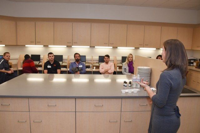 The Natick Soldier Research, Development and Engineering Center's Combat Feeding Directorate recently hosted Food Science & Industry Day. Jill Bates (far right), a CFD food technologist, provided a tour and demo in the CFD Technical Sensory lab (pictured here).