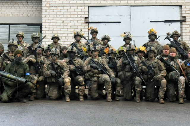 JONISKIS, Lithuania - U.S., Lithuanian and Latvian Soldiers gather together for a group photo at the end of Exercise Sun Stroke Oct. 30. Sun Stroke is the culminating exercise for the 6th Lithuanian Territorial Unit, which works to build readiness and conduct joint operations between the 6th Territorial Unit of Prisikelimo Military District, Lithuanian National Defense Volunteer Forces and Lithuania's NATO partners. It took place Oct. 28-30, and consisted of nearly 400 Soldiers from the United States, Lithuania, and Latvia.