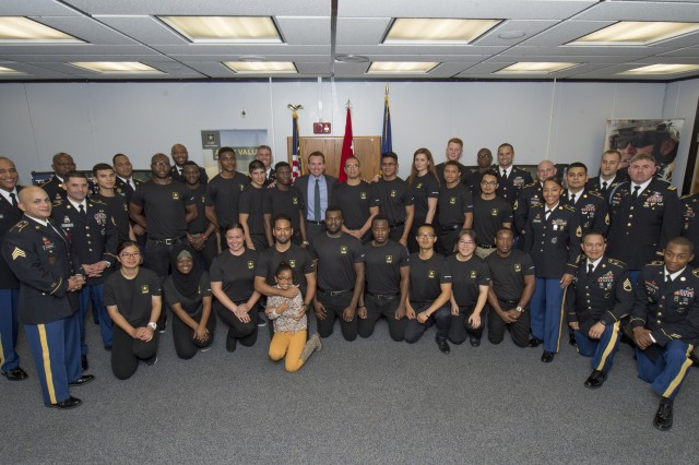 Harlem, N.Y. -- Secretary of the Army Eric Fanning stands with future Soldiers and recruiters from the Harlem center on Thursday Oct 27.  Secretary Fanning administered the oath to 22 future Soldiers in a ceremony at the Adam Clayton Powell State Office Building.