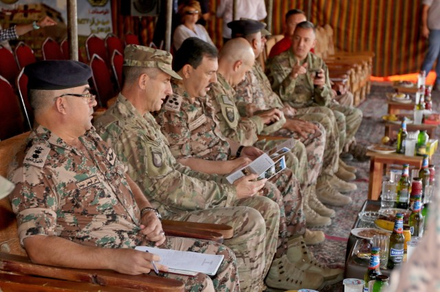 U.S. Army Maj. Gen. William Hickman (second from left), USARCENT Deputy Commanding General-Operations, Jordanian Army Brig. Gen. At-Tallah Smiran (third from left), Jordanian Armed Forces Artillery Director, and other senior military leaders wait to observe a combined live-fire exercise October 25, 2016. The Jordanian Army's 29th Royal HIMARS Battalion welcomed the senior military leaders to observe the culminating exercise after weeks of working side-by-side with the U.S. Army's 3rd Battalion, 321st Field Artillery Regiment.