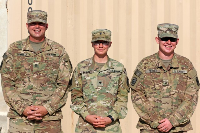 Staff Sgt. Albert Connelly, from Elkhart, Indiana, Spc. Lorraine Walsh, from Vermillion, South Dakota, and Pfc. William Porter, from Shafter, California, pose for a picture October 26 while deployed in the Middle East. The three, multiple launch rocket system crewmembers, made up one of the crews for a live-fire exercise with the Jordanian 29th Royal HIMARS Battalion.