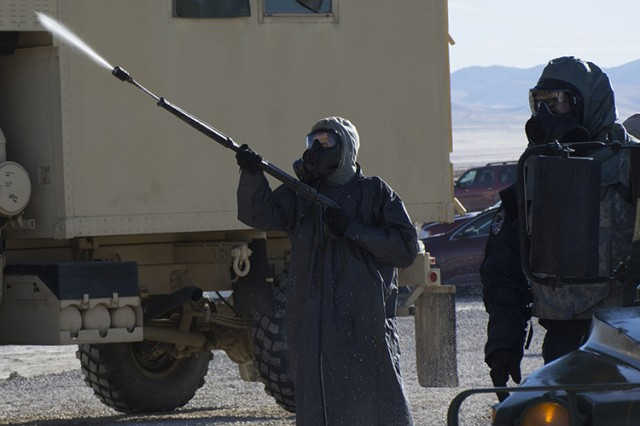 The first spray of decontaminant is aimed toward a truck Oct. 20, 2016 demonstration of emerging decontamination technologies at Dugway Proving Ground, Utah. The demonstration was hosted by Department of Defense's Joint Program Manager for Protection. Only simulated agent is used outdoors. Photo by Al Vogel, Dugway Public Affairs