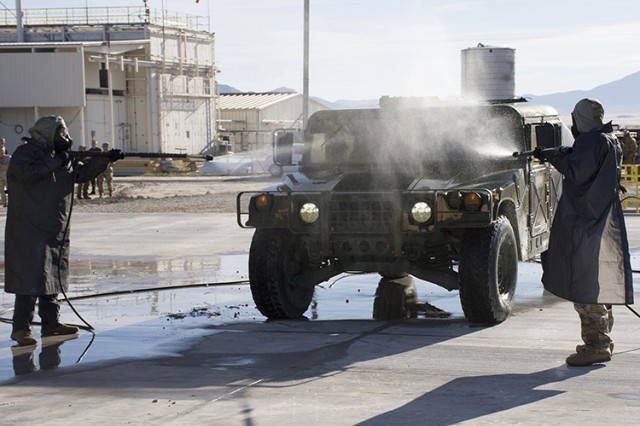 A Humvee is decontaminated during an Oct. 20, 2016 demonstration of emerging decontamination technologies at Dugway Proving Ground, Utah. The demonstration was hosted by Department of Defense's Joint Program Manager for Protection, and viewed by some 70 WMD experts from the U.S., Canada and United Kingdom. Simulated agent was used. Photo by Al Vogel, Dugway Public Affairs