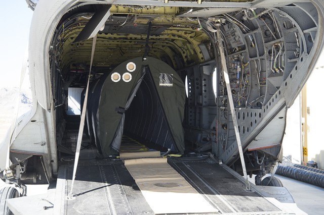 The CBRN (Chemical, Biological, Radiological, Nuclear) Aircraft Survivability Barrier inside a large helicopter. Contaminated personnel enter the tent-like chamber for removal to a decontamination area, without contaminating the craft's interior or flight personnel.Photo by Crystal Bowman, Dugway Optics Branch