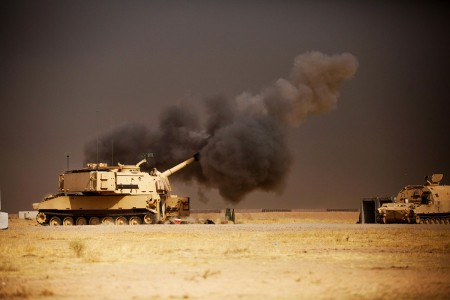 A U.S. Army M109A6 Paladin conducts a fire mission at Qayyarah West, Iraq, in support of the Iraqi security forces' push toward Mosul, Oct. 17, 2016.  The support provided by the Paladin teams denies the Islamic State of Iraq and the Levant safe havens while providing the ISF with vital artillery capabilities during their advance. The United States stands with a Coalition of more than 60 international partners to assist and support the Iraqi security forces to degrade and defeat ISIL.