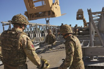 NATO forces train on bridge construction at Camp Darby