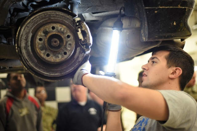 As part of a hands-on automotive course, Spc. John Boemisch of Headquarters and Headquarters Company, 12th Combat Aviation Brigade, inspects a car's brakes Oct. 26, 2016, at the U.S. Army Garrison Ansbach Automotive Skills Center in Ansbach, Germany. The course, which was organized through USAG Ansbach's Better Opportunities for Single Soldiers and the Directorate of Family and Morale, Welfare and Recreation, is part of the Department of the Army-funded BOSS Life Skills Program. (U.S. Army photo by Stephen Baack, USAG Ansbach Public Affairs)