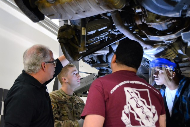 Richard Sepulveda, left, a technician at the U.S. Army Garrison Ansbach Automotive Skills Center in Ansbach, Germany, guides Soldiers through a brake inspection Oct. 26, 2016, as part of a hands-on automotive course. The course, which was organized through USAG Ansbach's Better Opportunities for Single Soldiers and the Directorate of Family and Morale, Welfare and Recreation, is part of the Department of the Army-funded BOSS Life Skills Program. (U.S. Army photo by Stephen Baack, USAG Ansbach Public Affairs)
