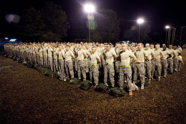 Soldiers and Army cadets stand in formation on the first day of the air assault course at Kirby Field on Fort Benning, Ga., July 14, 2013. The 12-day course consists of three phases: combat assault operations, sling-load operations and rappelling.