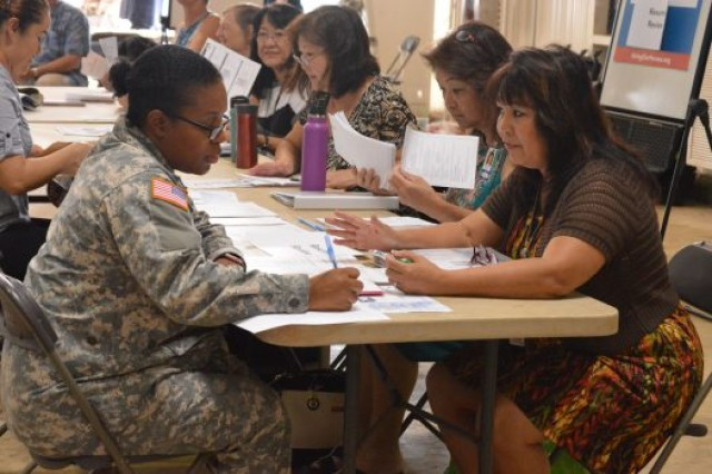 Army Spc. Letecia Adams receives resume help from Lorna Fredeluces, an employment service specialist with the Hawaii Department of Labor and Industrial Relations.