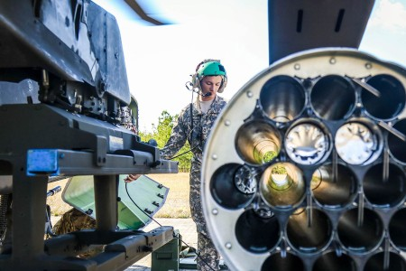 A member of 1st Attack Reconnaissance Battalion, 82nd Combat Aviation Brigade's armament team, conducts a routine inspection of an AH-64D Apache before an aerial gunnery training exercise at Fort A.P. Hill, Va., Oct. 24.