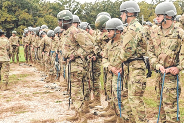 Soldiers-in-training with Co. C, 787th MP Bn., learn to tie their harnesses before going onto the 47-foot Warrior Tower at Fort Leonard Wood