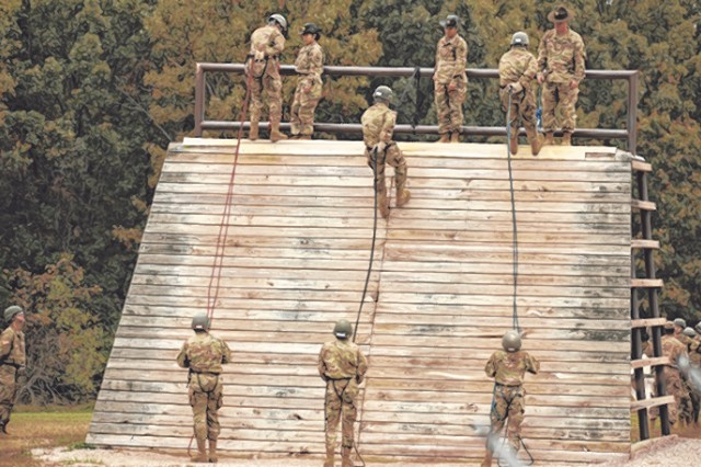 Soldiers-in-training with Co. C, 787th MP Bn., must first rappel down the practice wall before climbing the Warrior Tower.