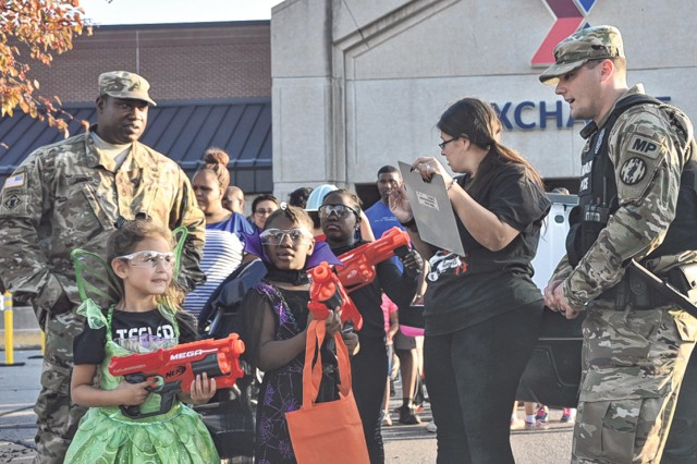"Sgt. Joseph Beardsley, far right, explains ""Zombie Attack"" rules to children before entering the maze Friday at the Exchange."