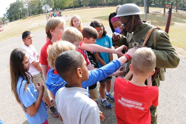 Students get to check out a uniform similar to those worn by Soldiers during World War I.