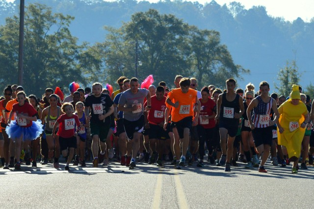 Runners head out at the start of the Spooky 5k Oct. 29 at Lake Tholocco.