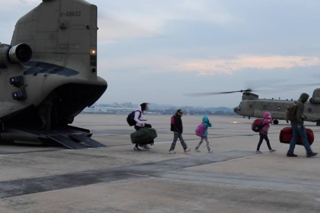 DoD family members depart two Chinook helicopters at Daegu Airbase while role-playing as Non-Combatant Evacuees during the Courageous Channel 2016 exercise, Nov. 1.