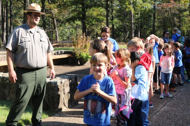 Seth Fisher, a natural resource specialist with Little Rock District U.S. Army Corps of Engineers guides students from Heber Springs, Arkansas during a field trip to Greers Ferry October 27.