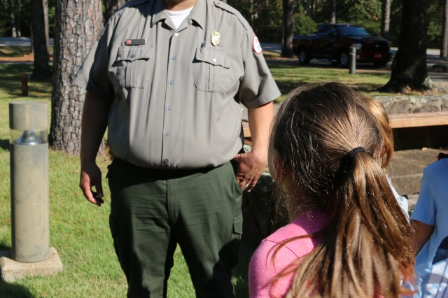 Seth Fisher, a natural resource specialist with Little Rock District U.S. Army Corps of Engineers talks with students from Heber Springs, Arkansas during a field trip to Greers Ferry October 27.