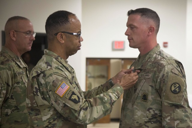 80th Training Command Commander Maj. Gen. A.C. Roper pins the Army Achievement Medal on Sgt. 1st Class Kevin Hiles for winning the command's Noncommissioned Officer Instructor of the Year at Fort Knox, Ky., Oct. 23, 2016.