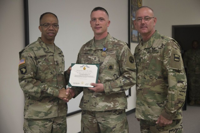 80th Training Command Commander Maj. Gen. A.C. Roper and Command Sgt. Maj. Jeffrey Darlington, command sergeant major of the 80th, present the Army Achievement Medal to Sgt. 1st Class Kevin Hiles for winning the 80th's 2016 Instructor of the Year as the top Noncommissioned Officer IOY at Fort Knox, Ky., Oct. 23, 2016.
