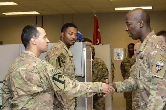 Command Sgt. Maj. David M. Clark, Senior Enlisted Leader for NATO's Resolute Support (RS), U.S. Forces-Afghanistan (USFOR-A) visit, 204th Engineer Detachment (EN. DET.), Construction Management Team (CMT), 1st Cavalry Division Resolute Support Sustainment Brigade (1CD RSSB) during his visit Nov. 5. Although time was limited during his visit, every moment was filled with an opportunity to engage Soldiers. He took a moment speak with Sgt. Maj. Kenneth White, command sergeant major, 204th EN. DET., CMT to find talk about some of the CMT projects being conducted.