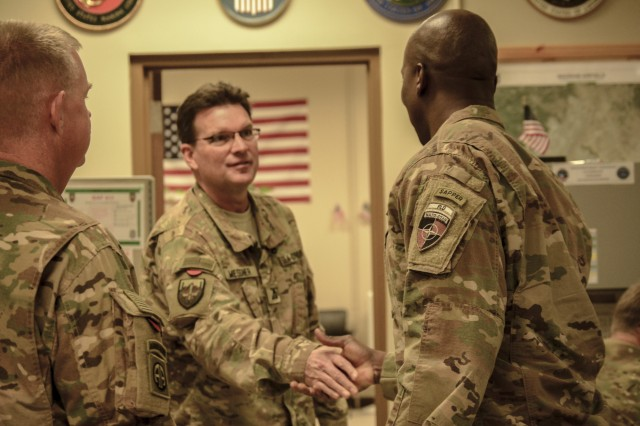 Command Sgt. Maj. David M. Clark, Senior Enlisted Leader for NATO's Resolute Support (RS), U.S. Forces-Afghanistan (USFOR-A) spoke with Phil Messner, Defense Logistics Agency (DLA) Support Team Deputy, who works hand in hand with the 1st Cavalry Division Resolute Support Sustainment Brigade (1CD RSSB), Nov. 5.