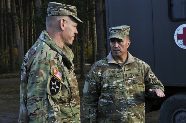 U.S. Army Brig. Gen. Kenneth L. Kamper (left), deputy commanding general, 4th Infantry Division, speaks with Col. Christopher Norrie, commander, 3rd Armored Brigade Combat Team, 4th Inf. Div., about different range capabilities during their pre-deployment site survey at Camp Karliki, in Zagan, Poland, Nov. 3, 2016. The survey was part of the pre-deployment stage for Fort Carson, Colorado, units as its leaders view locations throughout Poland for its upcoming tour-of-duty. (U.S. Army photo by Sgt. William A. Tanner)