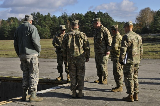 U.S. Army Brig. Gen. Kenneth L. Kamper, deputy commanding general, 4th Infantry Division, discusses different rail loading strategies with leaders assigned to 3rd Armored Brigade Combat Team, 4th Inf. Div., during a pre-deployment site survey at Camp Karliki, in Zagan, Poland, Nov. 3, 2016. The survey was part of the pre-deployment stage for Fort Carson, Colorado, units as its leaders view locations throughout Poland for its upcoming tour-of-duty. (U.S. Army photo by Sgt. William A. Tanner)