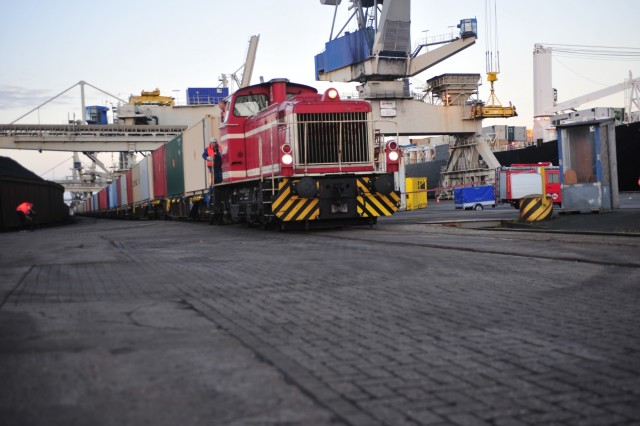 A train pulling cars of Army and Air Force ammunition moves out of the port Oct. 29 at Nordenham, Germany for movement to Miesau Army Depot, Miesau, Germany. More than 600 containers of ammunition arrived at the port and were shipped to the depot for storage and distribution throughout Europe. This is the largest Army-run shipment of ammunition to Europe in more than 20 years.