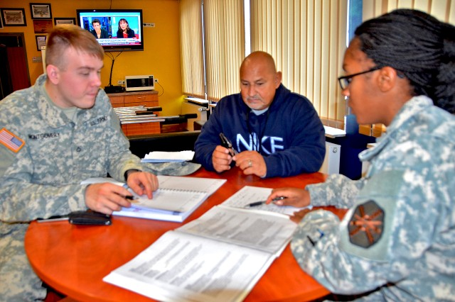 The Wiesbaden Better Opportunities for Single Soldiers team -- Pfc. Uriah Montgomery (from right), Steve Eclavea and Sgt. Helen Buford -- discuss upcoming projects and events.