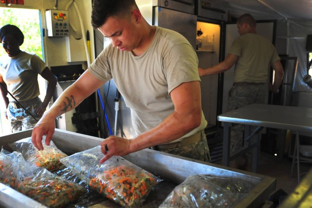 Spc. Samuel Shaaheed, a culinary specialist with the 407th Brigade Support Battalion, 2nd Brigade Combat Team, 82nd Airborne Division, prepares food for Soldiers during a multi-day field exercise inside of the Brigade Support Area (BSA) on Fort Bragg, N.C., Aug. 9, 2016. The 407th BSB's BSA provides logistics support for the brigade as they conduct a Combined Arms Live Fire Exercise in preparation for battalion-level live fire exercises later this year, keeping Paratroopers ready to jump, fight and win.